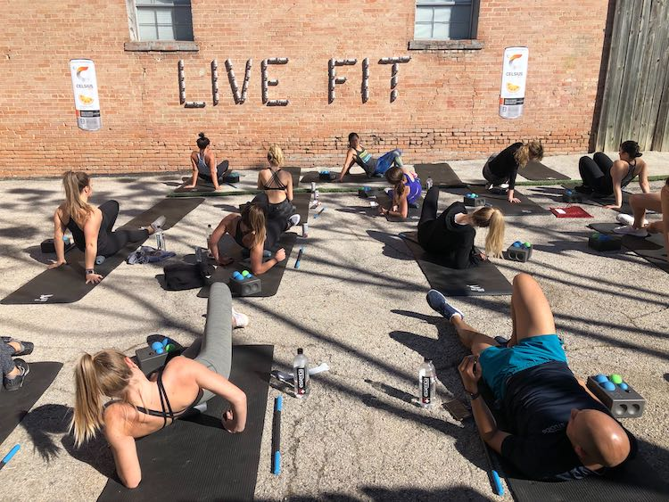 image of people working out next to a wall that says live fit