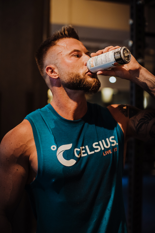 image of a man in celsius apparel drinking a celsius
