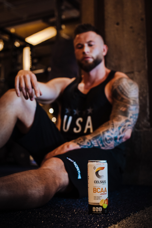 image of a man sitting behind a bcaa celsius can