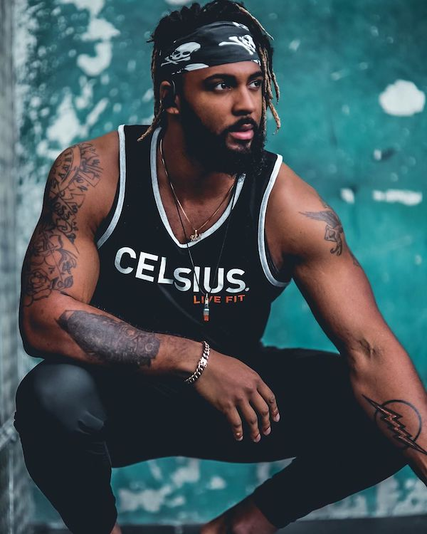 image of a man squatting in celsius apparel