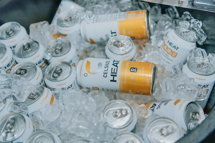 image of a cooler full of ice and jackfruit celsius heat cans