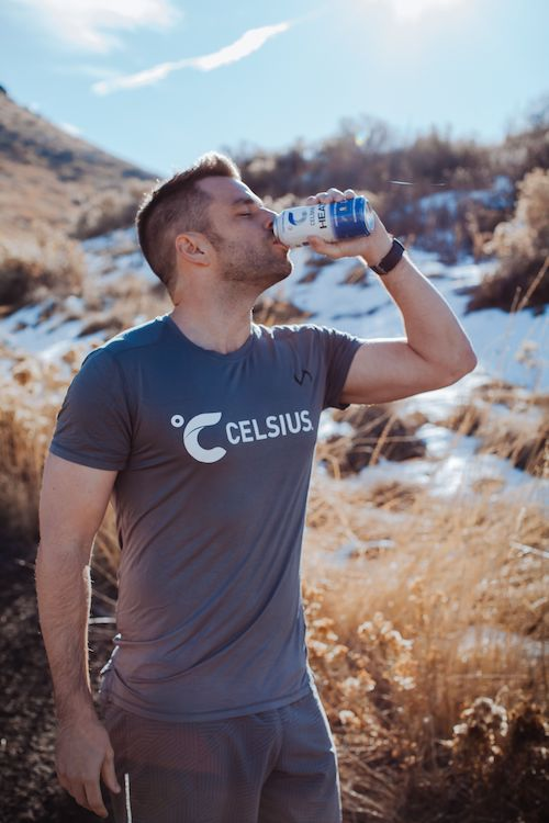 image of a man in celsius apparel drink celsius heat