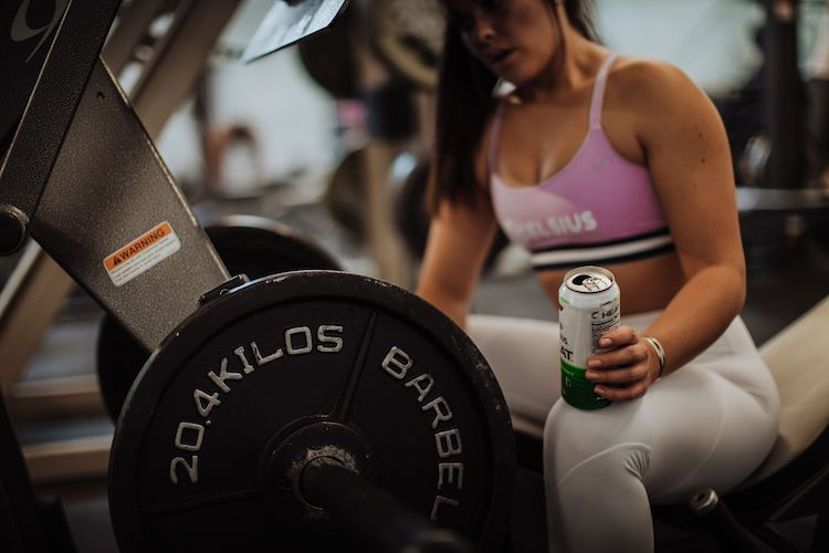 image of a woman working out wearing celsius apparel holding a celsius heat