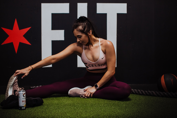 image of a woman stretching in celsius apparel